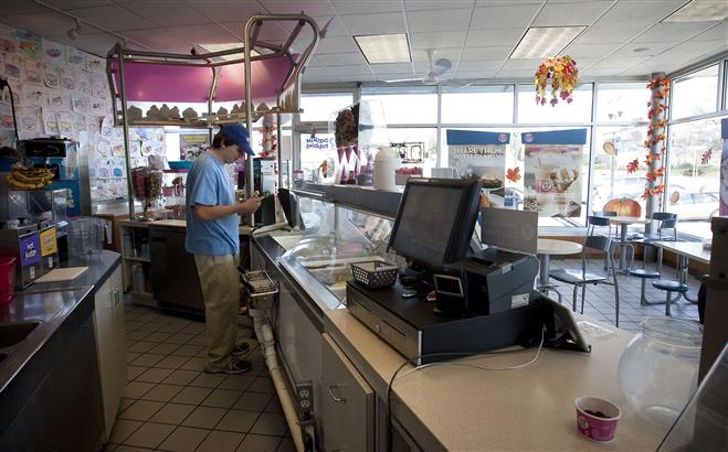 Danny Leffler gathers materials to decorate an ice cream cake in the Baskin Robbins ice cream shop on Wauwatosa Avenue on Nov. 14. Leffler is a former Wauwatosa East High School student and currently part of Next Steps.