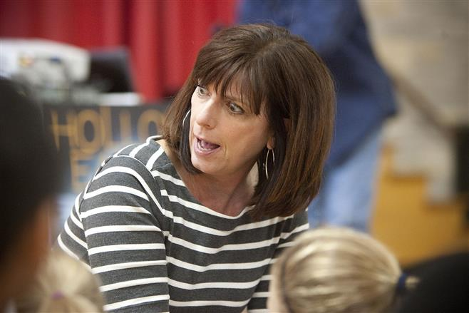 Children's book author Carole Barrowman addresses third-, fourth- and fifth-grade students at Underwood Elementary School on Tuesday.