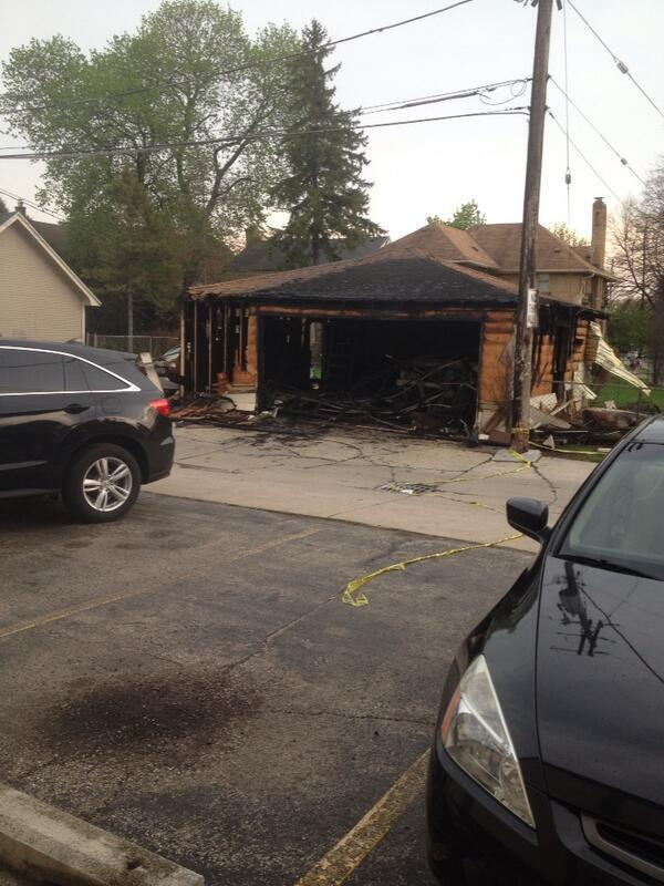 Two cars caught fire inside this Wauwatosa garage Sunday, causing extensive damage.