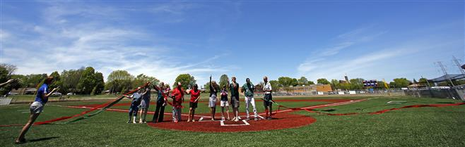 School officials cut colored ribbons to dedicate two new baseball fields at Dale Breitlow Field on Saturday, May 24. Wauwatosa West played Wauwatosa East in the opening game.