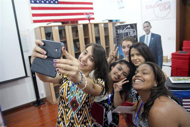 Wauwatosa West Senior Alexis Hardy (bottom right) joins three Tajkistani students and one from Connecticut (left) in taking a selfie at the international iEARN conference in Tajikistan, where students practiced photojournalism.