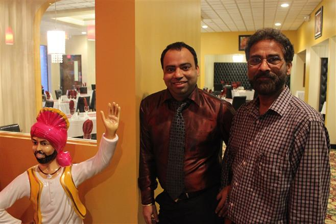 Charnjit Bolla is ready for diners at his new restaurant, India Garden, with his father Baldev Bolla (right).