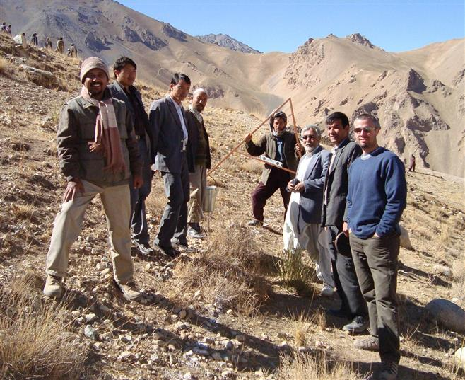 Schmitt (right) stands with local men while working on a watershed project in Bamiyan, Afghanistan. He is a Tosa native.