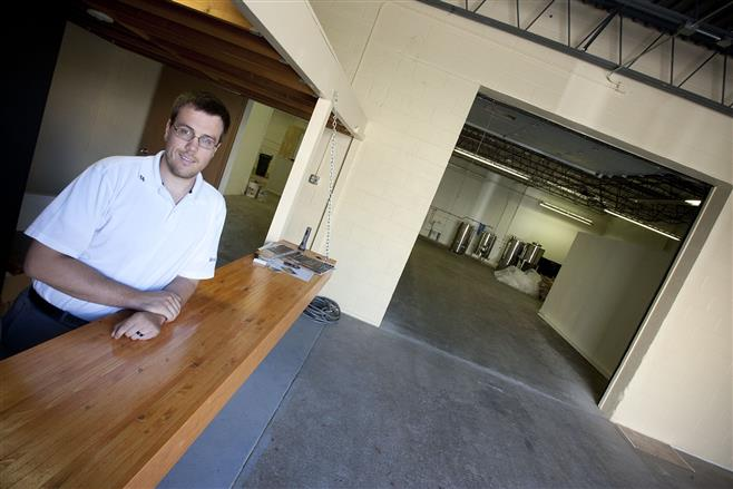 Andrew Dillard is seen in what will be the public area of a brew pub he is building in an industrial building at the intersection of 62nd and State streets.