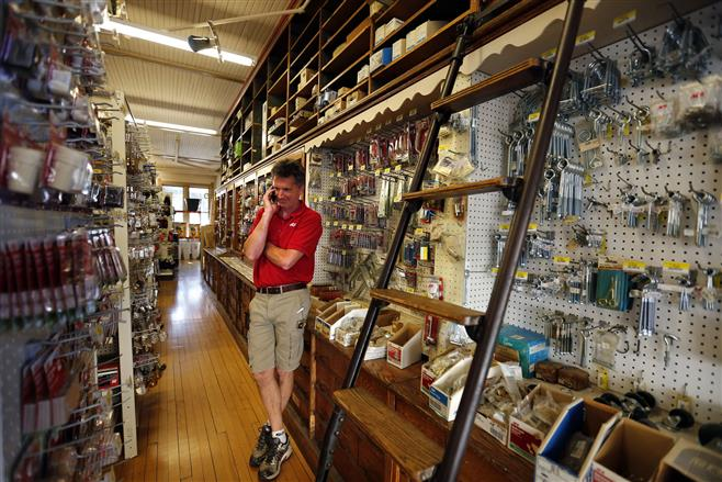 Jeffrey Rauh, owner of Robertson Ace Hardware, talks on his phone in the store on Tuesday.