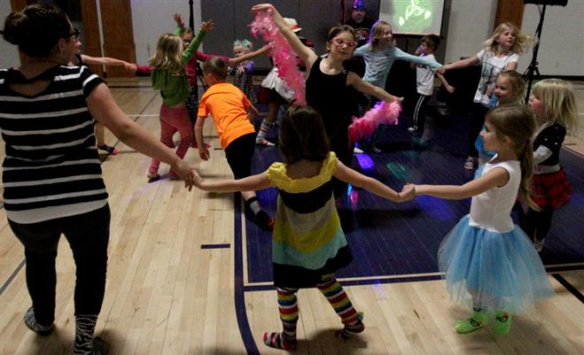 Children cicle up and dance during the first Sock Hop at the Wauwatosa Montessori School on May 16.
